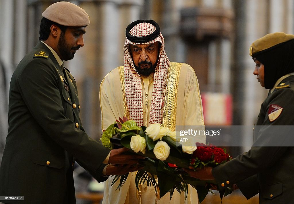 Emirati President Sheikh Khalifa bin Zayed al-Nahayan (C) lays a wreath on the tomb of the Unknown Warrior in Westminster Abbey in central London on May 1, 2013 on the second day of his state visit to Britain. The UAE president was to face questions from Prime Minister David Cameron during a meeting over allegations that three British men jailed in Dubai were tortured.