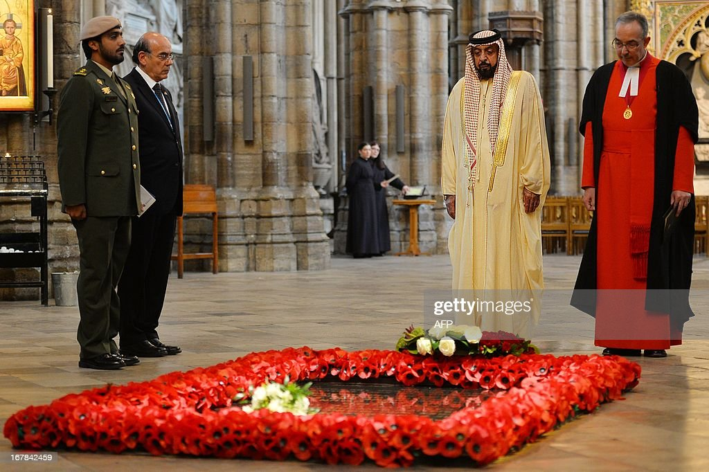 Emirati President Sheikh Khalifa bin Zayed al-Nahayan (2R) lays a wreath on the tomb of the Unknown Warrior as Dean of Westminster John Hall looks on (R) in Westminster Abbey in central London on May 1, 2013 on the second day of his state visit to Britain. The UAE president was to face questions from Prime Minister David Cameron during a meeting over allegations that three British men jailed in Dubai were tortured.