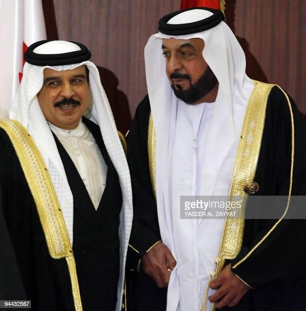 Emirati President Sheikh Khalifa bin Zayed alNahayan stands next to Bahraini King Hamad bin Issa alKhalifa as they arrive to attend the Gulf...