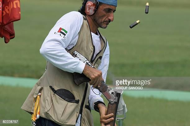 Emirati shooter Sheikh Ahmed bin Hasher alMaktoum a member of Dubai's ruling family empties cartridges from his rifle during the men's trap shooting...