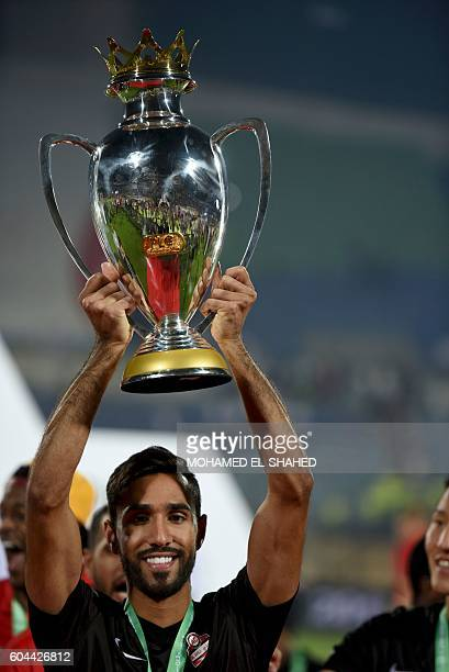 Emirati teams AlAhli player Celebrates after winning the Arabian Gulf Super Cup after their match between them and Emirati teams AlJazira at the 30...