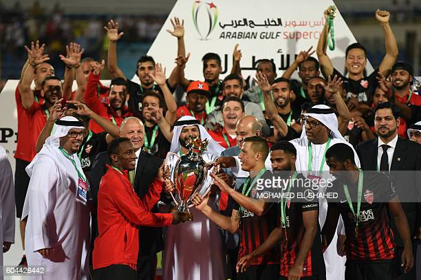 Emirati teams AlAhli players Celebrate after winning the Arabian Gulf Super Cup after their match between them and Emirati teams AlJazira at the 30...
