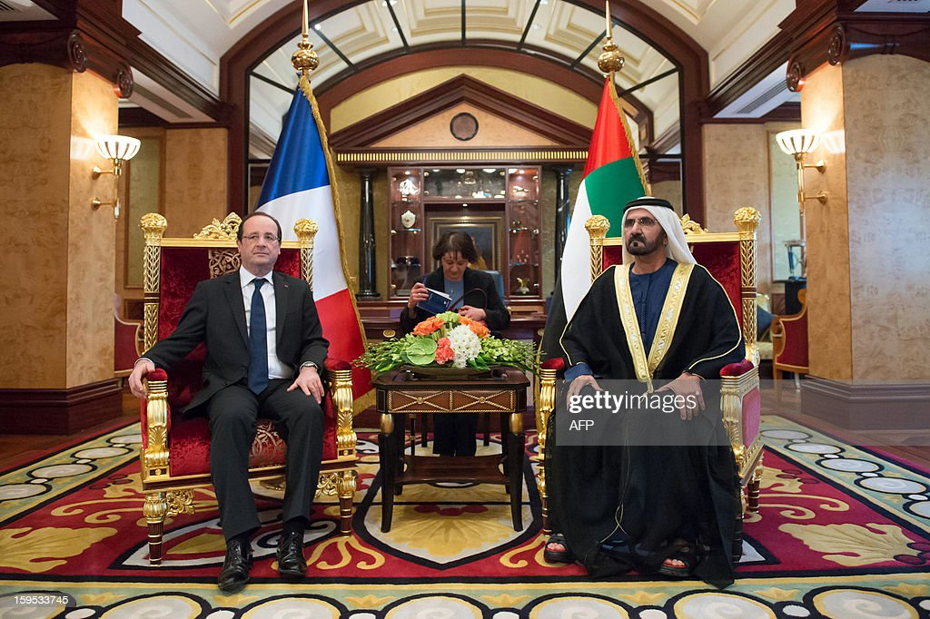 Emirati vice president and ruler of Dubai Sheikh Mohamed bin Rashid al-Maktoum (R) and France's President Francois Hollande (L) take part in a meeting at the Al-Mushrif presidential palace in Abu Dhabi on January 15, 2013. French President Francois Hollande, defended his country's intervention in Mali, saying it had prevented the African country from being overrun by 'terrorists'.