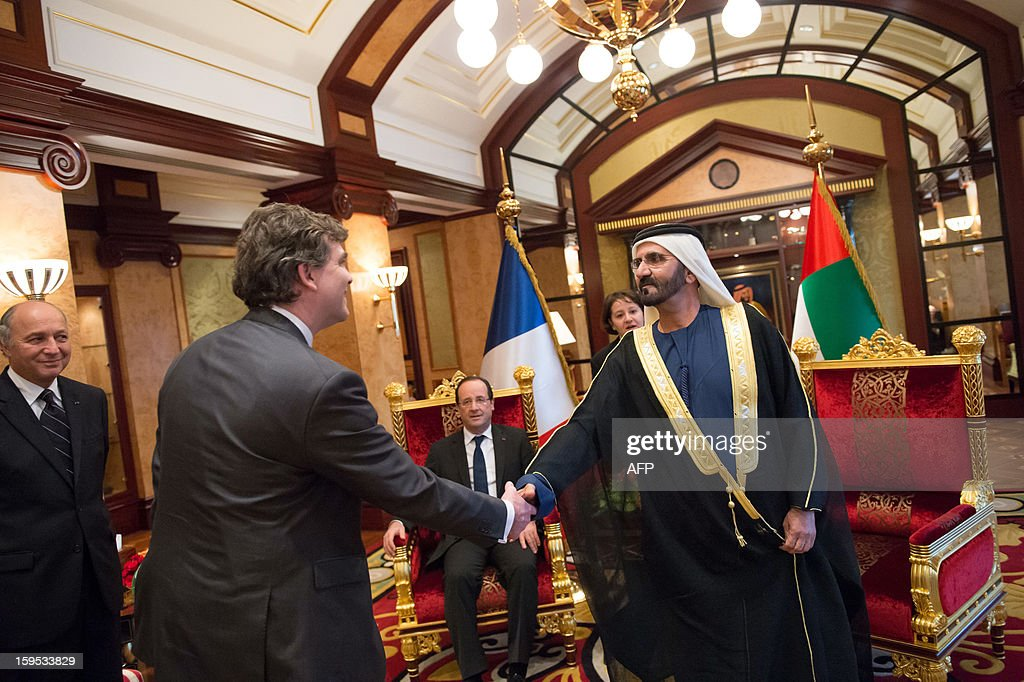 Emirati vice president and ruler of Dubai Sheikh Mohamed bin Rashid al-Maktoum (R) shakes hands with French Minister for Industrial Recovery Arnaud Montebourg (L) as he welcomes France's President Francois Hollande (C) to take part in a meeting at the Zaabel Palace in Dubai on January 15, 2013. French President Francois Hollande, defended his country's intervention in Mali, saying it had prevented the African country from being overrun by 'terrorists'.