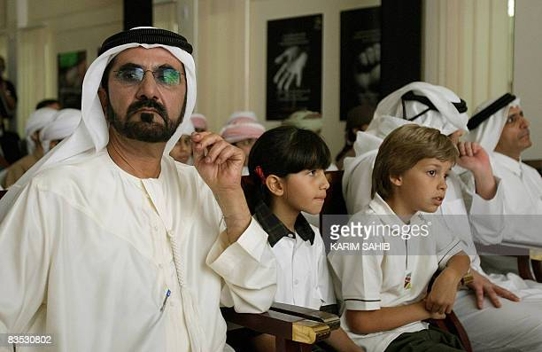 Emirati vice president prime minister and ruler of Dubai Sheikh Mohammed bin Rashed alMaktoum sits among students of AlMaktoum School in the Gulf...