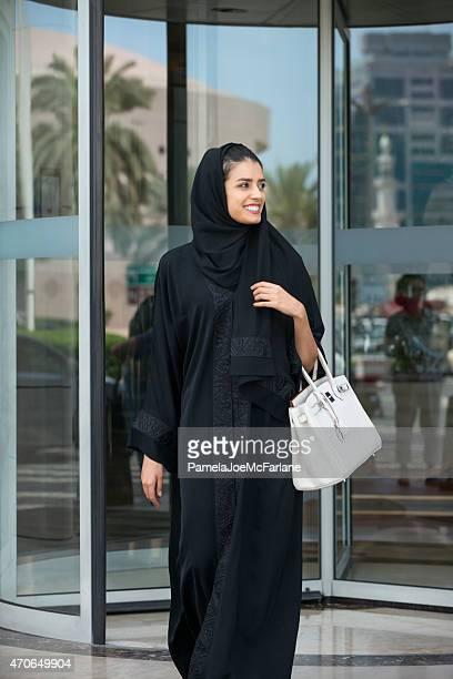 Emirati Woman in Abaya Leaving Hotel Through Revolving Doors