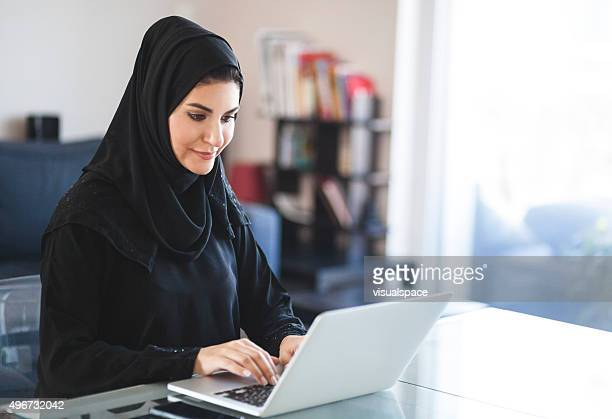 Emirati Woman Working with Laptop at Home