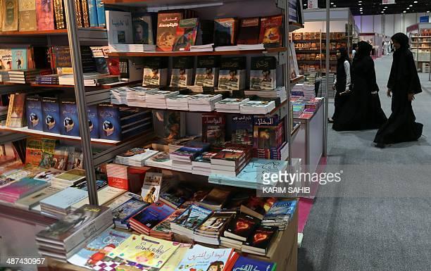Emirati women visit the Abu Dhabi International Book Fair on April 30 2014 in the Emirati capital 'Frankenstein in Baghdad' a novel by Iraqi novelist...