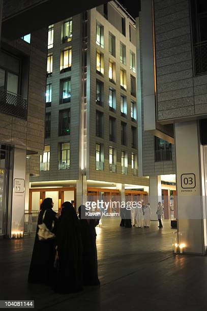 Emiratis in their traditional costume enjoy an arts evening held at galleries and public spaces in Dubai International Financial Centre The DIFC is...