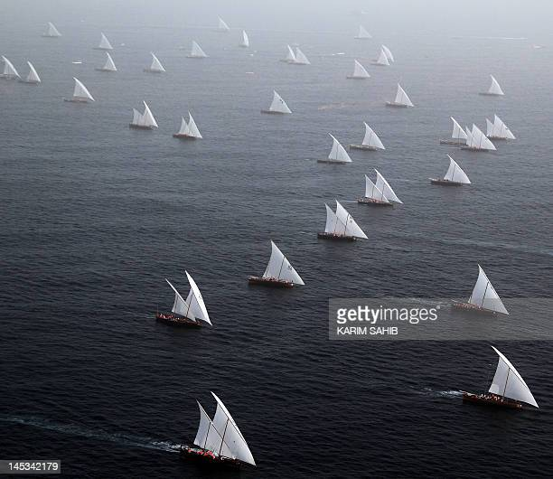 Emiratis sail during the AlGaffal traditional longdistance dhow sailing race between the island of Sir Bu Nair near the Iranian coast and the Gulf...