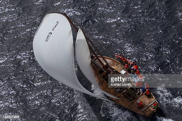 Emiratis sail towards the finishing line near Dubai during the AlGaffal traditional longdistance dhow sailing race between the island of Sir Bu Nair...