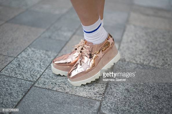 Emma Albarran attends the DISCOVERED show during Tokyo Fashion Week wearing D Squared skirt Stella McCartney shoes Fendi bag Eleonova top Dior...