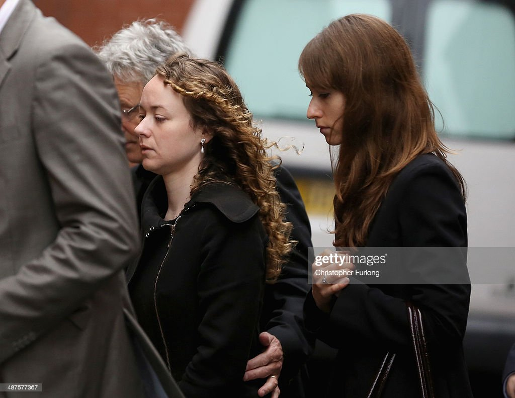 Emma (R) and Kerry Maguire (C), the daughters of murdered teacher Ann Maguire, arrive at Leeds Youth Court as a pupil of Corpus Christi Catholic College appears in court and was remanded in custody charged with Mrs Maguire's murder on May 1, 2014 in Leeds, England. A fifteen year old male student has been arrested and charged with the murder of teacher Ann Maguire, 61, who died from multiple stab wounds after the attack in her classroom at Corpus Christi Catholic College.