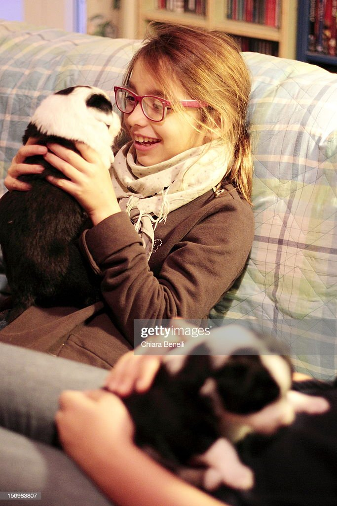 Emma and your puppy : Stock Photo