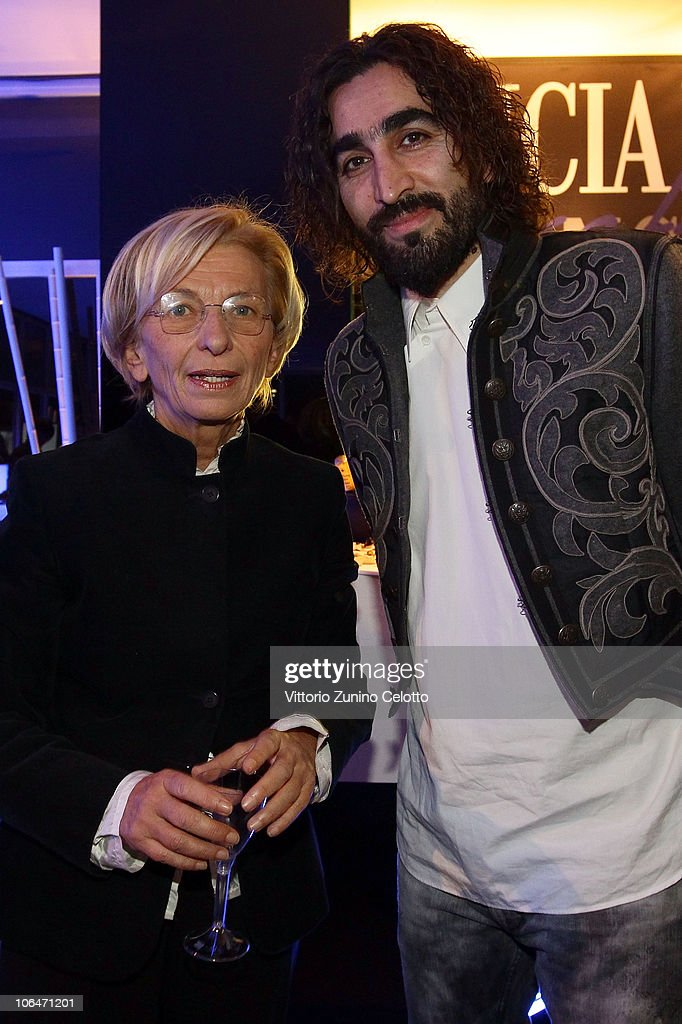 <a gi-track='captionPersonalityLinkClicked' href=/galleries/search?phrase=Emma+Bonino&family=editorial&specificpeople=539913 ng-click='$event.stopPropagation()'>Emma Bonino</a> and Fariborz Kamkari attend the Lancia Cafe during the 5th Rome International Film Festival on November 2, 2010 in Rome, Italy.
