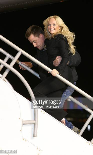 Emma Bunton is helped up the stairs before she joins The Spice Girls to unveil the new name Spice One of a Virgin Atlantic Jet at the Flight Path...
