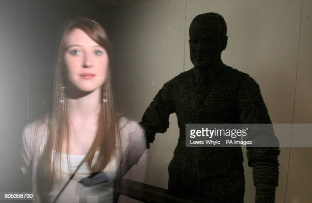 Emma Burns is reflected in the glass surrounding the statue of her Great Grandfather RJ Mitchell the designer of the Spitfire aeroplane as it is...