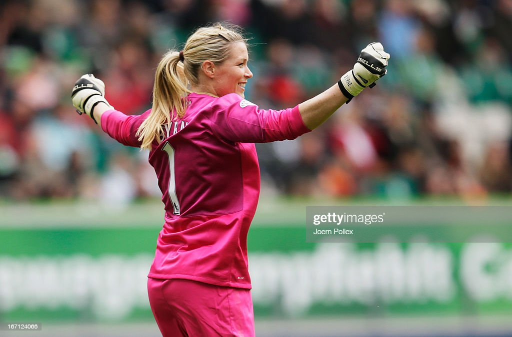 Emma Byrne of Arsenal celebrates after Kim Little of Arsenal scored her team's first goal during the Women's Champions League semi-final second leg match between VfL Wolfsburg and Arsenal Ladies FC at Volkswagen Arena on April 21, 2013 in Wolfsburg, Germany.