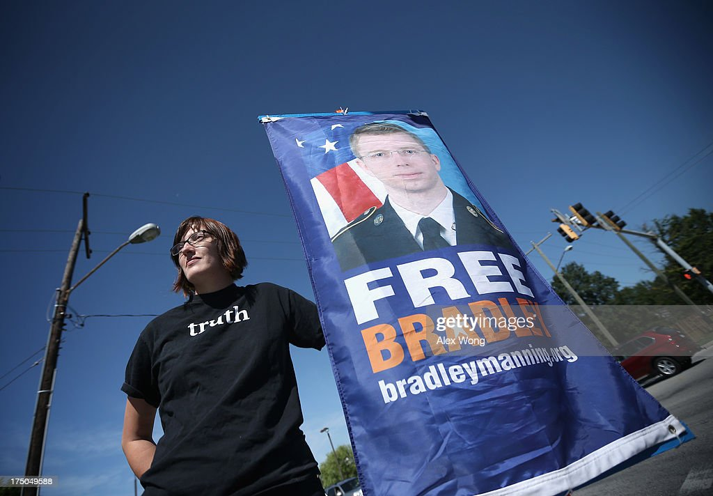 Emma Cape, a supporter of U.S. Army Pfc. Bradley E. Manning, holds a sign during a demonstration outside the main gate of Ft. Meade July 30, 2013 in Maryland. Military Judge Col. Denise Lind, who is presiding in the case of United States vs. Pfc. Bradley E. Manning, has reached a verdict and she is scheduled to read the verdict at 1pm today. Manning could face a life sentence for charges of espionage, aiding the enemy and computer fraud, for passing classified documents to WikiLeaks.