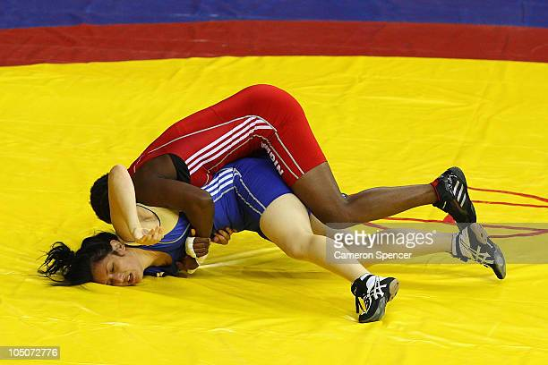 Emma Chalmers of Australia competes against Ifeoma Iheanacho of Nigeria in the women's 67kg 35 final at IG Sports Complex during day five of the...
