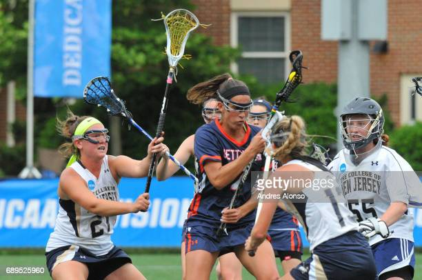 Emma Christie of Gettysburg College is swarmed by defenders from the College of New Jersey during the Division III Women's Lacrosse Championship held...