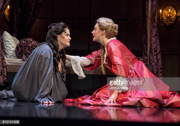 Emma Cunniffe as Anne and Romola Garai as Sarah Churchill perform on stage in a production of 'Queen Anne' by the RSC at Theatre Royal on July 6 2017...