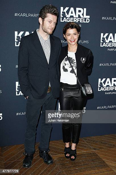 Emma de Caunes and her husband Jamie Hewlett attend the Karl Lagerfeld New Perfume launch party at Palais Brongniart on March 11 2014 in Paris France