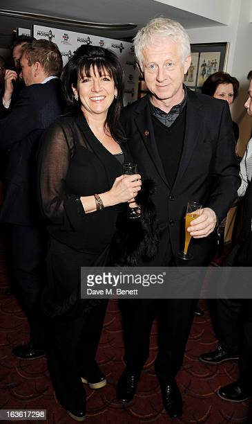 Emma Freud and Richard Curtis attend a gala performance of 'The Book Of Mormon' in aid of Red Nose Day at the Prince Of Wales Theatre on March 13...