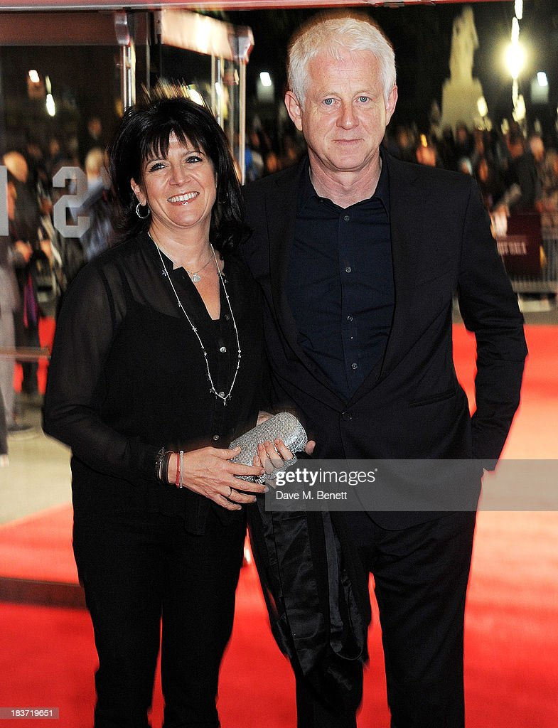 Emma Freud (L) and Richard Curtis attend the European Premiere of 'Captain Phillips' on the opening night of the 57th BFI London Film Festival at Odeon Leicester Square on October 9, 2013 in London, England.