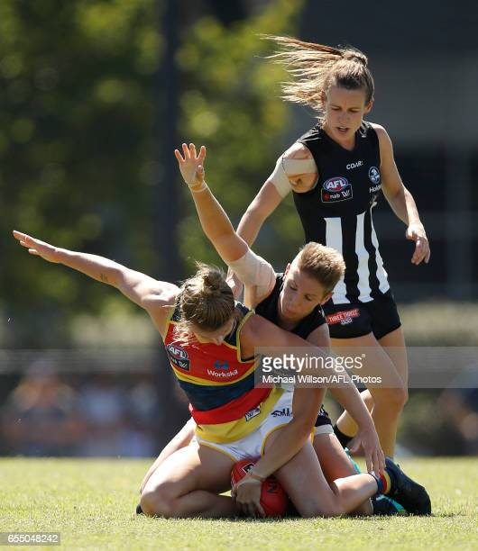 Emma Grant of the Magpies and Kellie Gibson of the Crows compete for the ball during the 2017 AFLW Round 07 match between the Collingwood Magpies and...