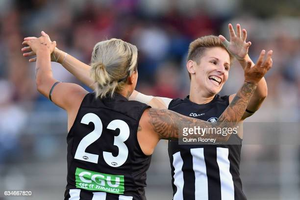Emma Grant of the Magpies is congratulated by Moana Hope of the Magpies after kicking a goal during the round two AFL Women's match between the...