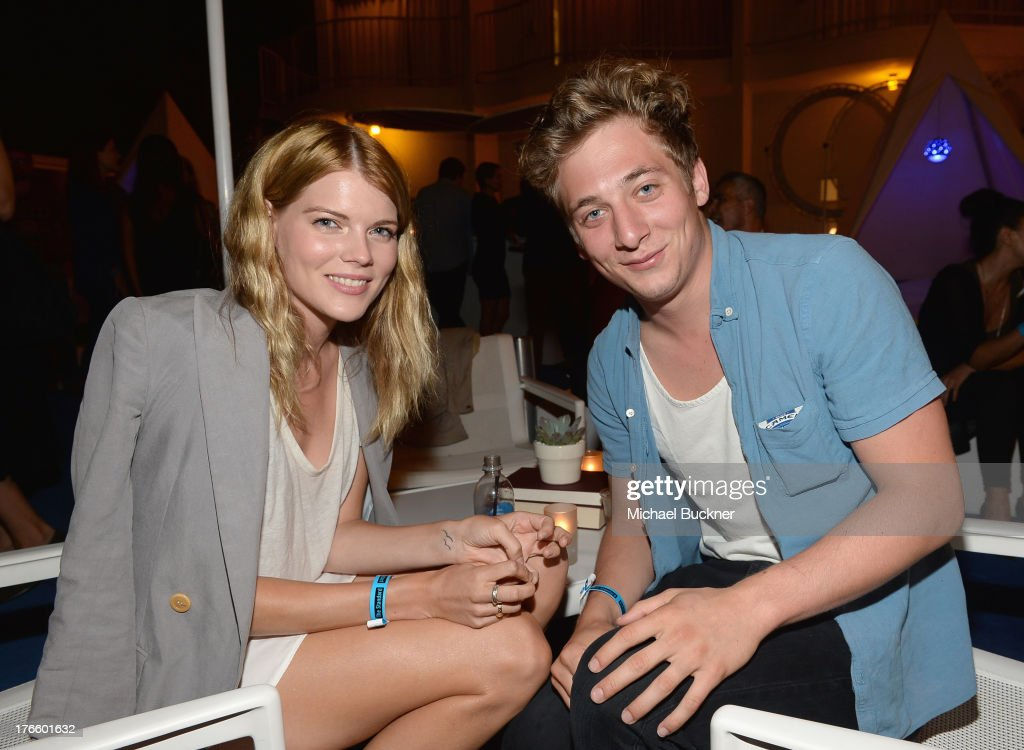 Emma Greenwell (L) and actor <a gi-track='captionPersonalityLinkClicked' href=/galleries/search?phrase=Jeremy+Allen+White&family=editorial&specificpeople=7366645 ng-click='$event.stopPropagation()'>Jeremy Allen White</a> attend Warby Parker's store opening in The Standard, Hollywood on August 15, 2013 in Los Angeles, California.