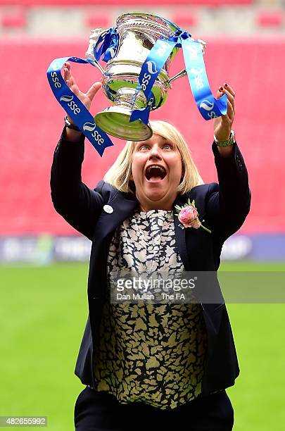 Emma Hayes Manager of Chelsea celebrates with the trophy after victory during the Women's FA Cup Final between Chelsea Ladies FC and Notts County...