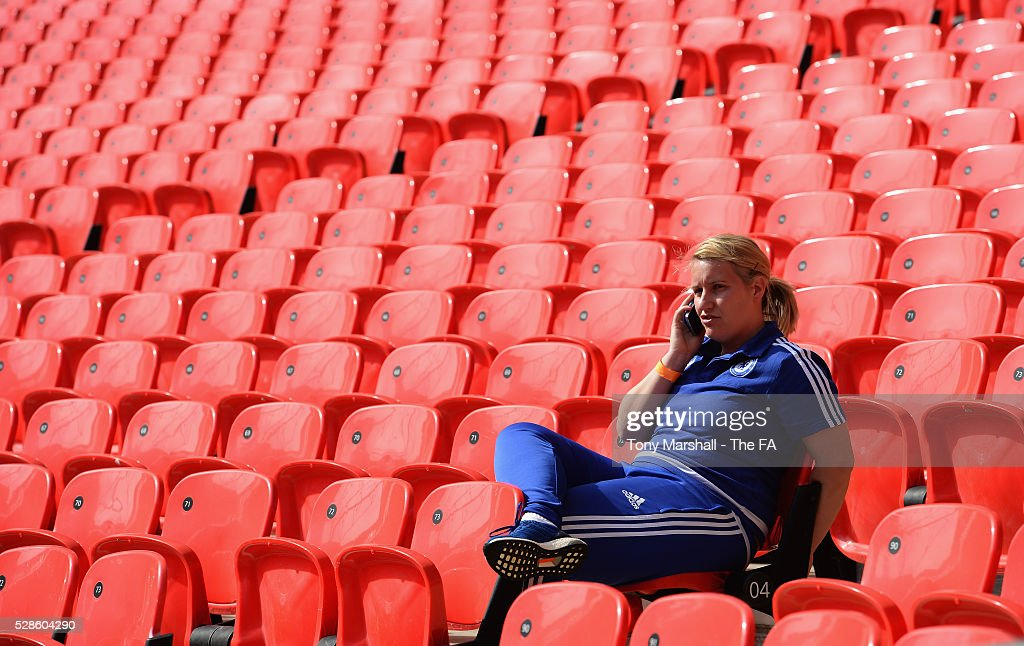 Emma Hayes, manager of Chelsea FC Ladies talks on the phone during the SSE Women's FA Cup Final - Wembley Media Day at Wembley Stadium on May 6, 2016 in London, England.