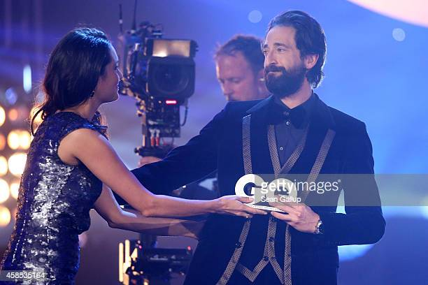 Emma HemingWillis and Adrien Brody are seen on stage at the GQ Men Of The Year Award 2014 at Komische Oper on November 6 2014 in Berlin Germany