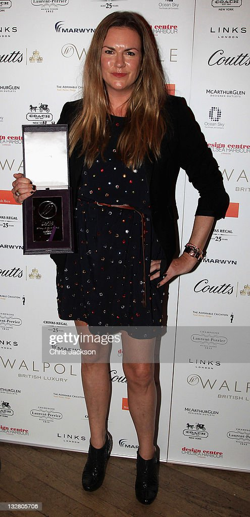 Emma Hill of Mulberry poses with the British Luxury Brand Abroad Award at the Walpole Awards of Excellence 2011 at Banqueting House on November 14, 2011 in London, England.
