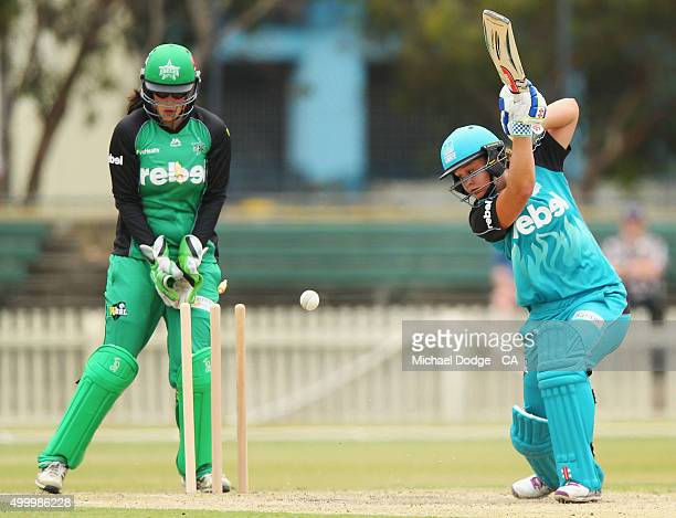 Emma Inglis of the Stars watches Barty of the Heat get bowled by Natalie Sciver during the Women's Big Bash League match between the Brisbane Heat...