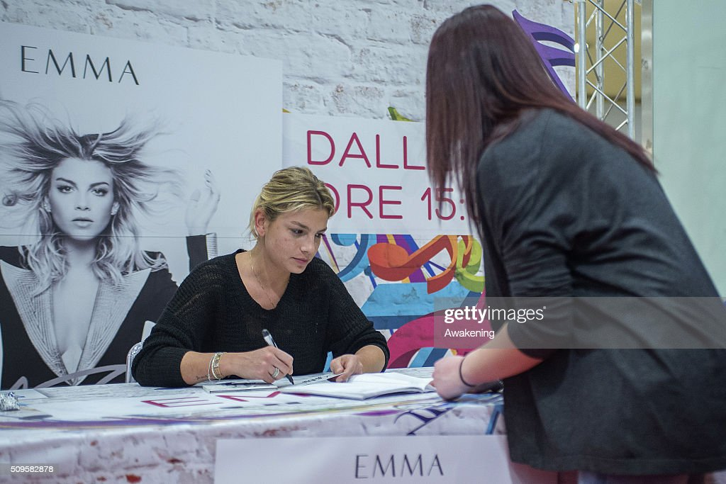 <a gi-track='captionPersonalityLinkClicked' href=/galleries/search?phrase=Emma+Marrone&family=editorial&specificpeople=6874512 ng-click='$event.stopPropagation()'>Emma Marrone</a> signs autographs during the presentation of 'Adesso' on February 11, 2016 in Turin.
