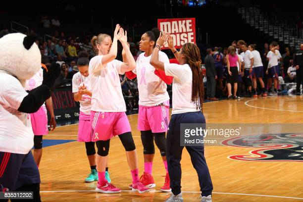 Emma Meesseman and Tierra RuffinPratt of the Washington Mystics shake hands before the game against the Phoenix Mercury on August 18 2017 at the...