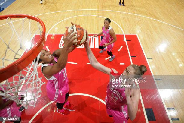 Emma Meesseman of the Washington Mystics and Krystal Thomas of the Washington Mystics go for the rebound during the game against the Los Angeles...