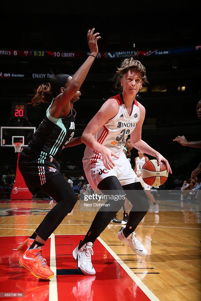 Emma Meesseman #33 of the Washington Mystics drives against Tina Charles #31 of the New York Liberty at the Verizon Center on August 16, 2014 in Washington, DC.