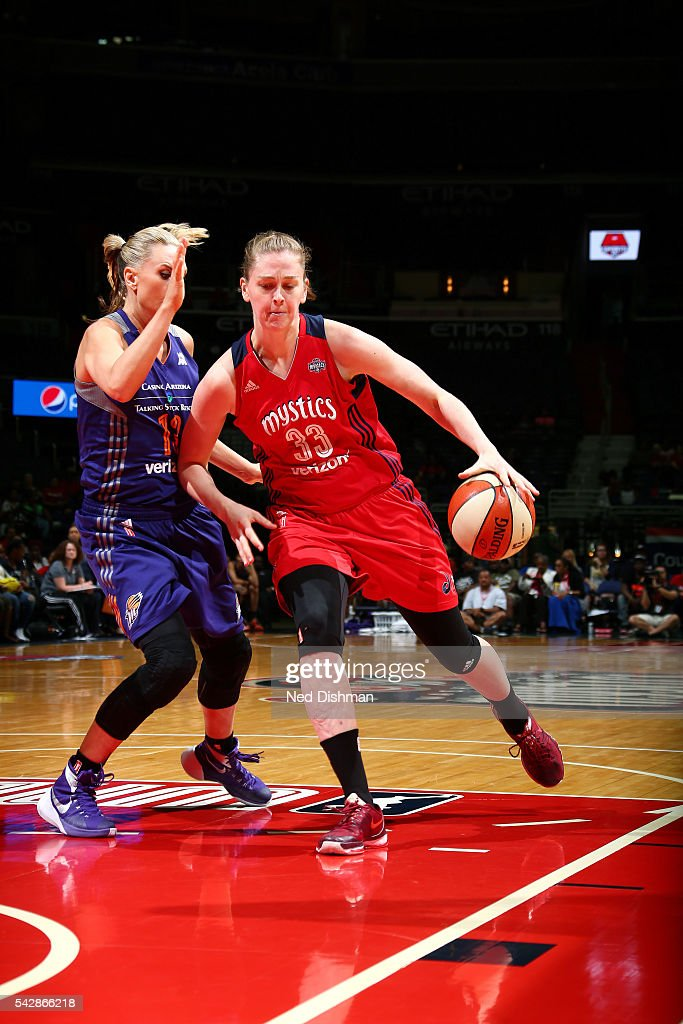 Emma Meesseman #33 of the Washington Mystics drives to the basket during the game against <a gi-track='captionPersonalityLinkClicked' href=/galleries/search?phrase=Penny+Taylor&family=editorial&specificpeople=206985 ng-click='$event.stopPropagation()'>Penny Taylor</a> #13 of the Phoenix Mercury during a WNBA game on June 24, 2016 at Verizon Center in Washington, DC.