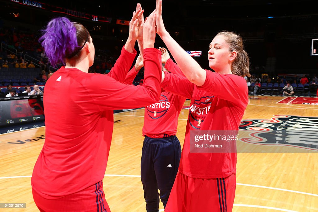 Emma Meesseman #33 of the Washington Mystics gives high fives to teammates before the game against the San Antonio Stars on June 29, 2016 at the Verizon Center in Washington, DC.