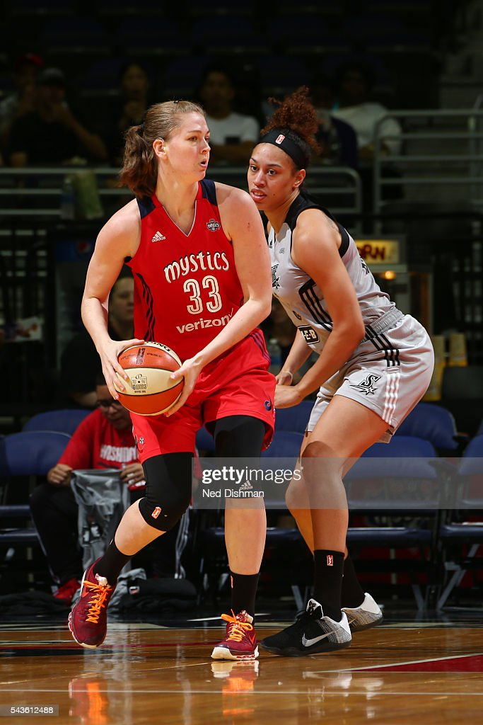 Emma Meesseman #33 of the Washington Mystics moves the ball against Dearica Hamby #5 of the San Antonio Stars on June 29, 2016 at the Verizon Center in Washington, DC.