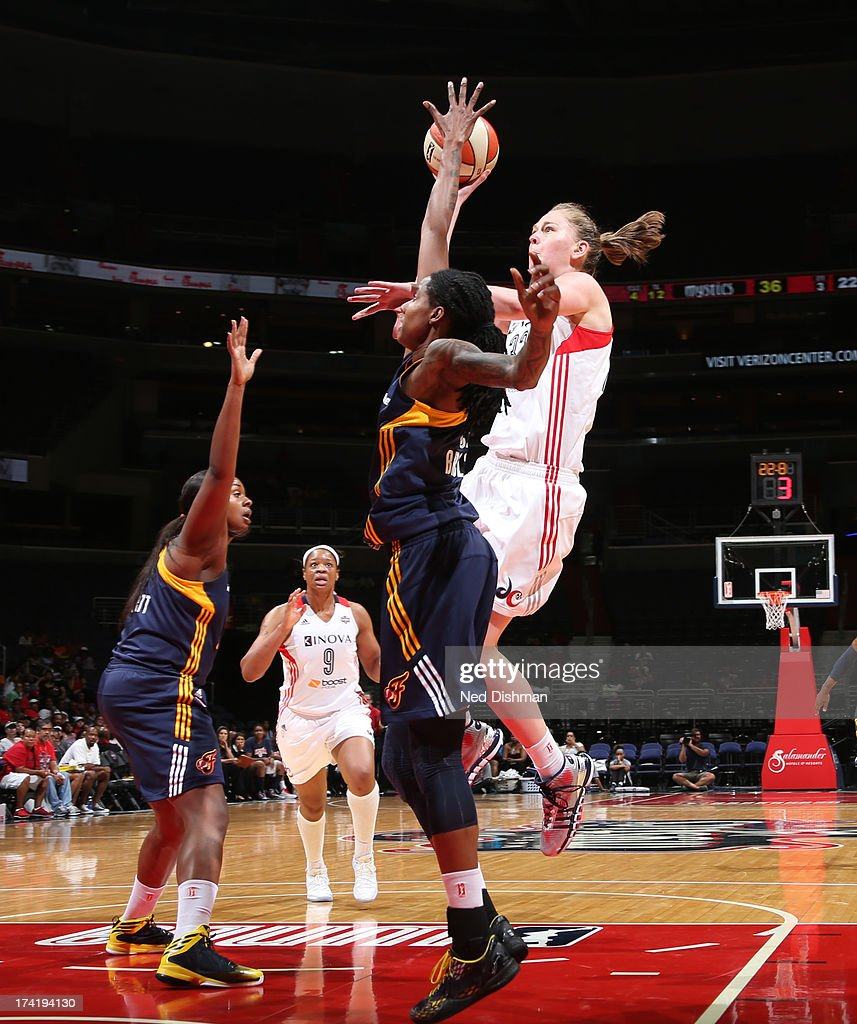 Emma Meesseman #33 of the Washington Mystics shoots against Jessica Breland #51 of the Indiana Fever at the Verizon Center on July 21, 2013 in Washington, DC.