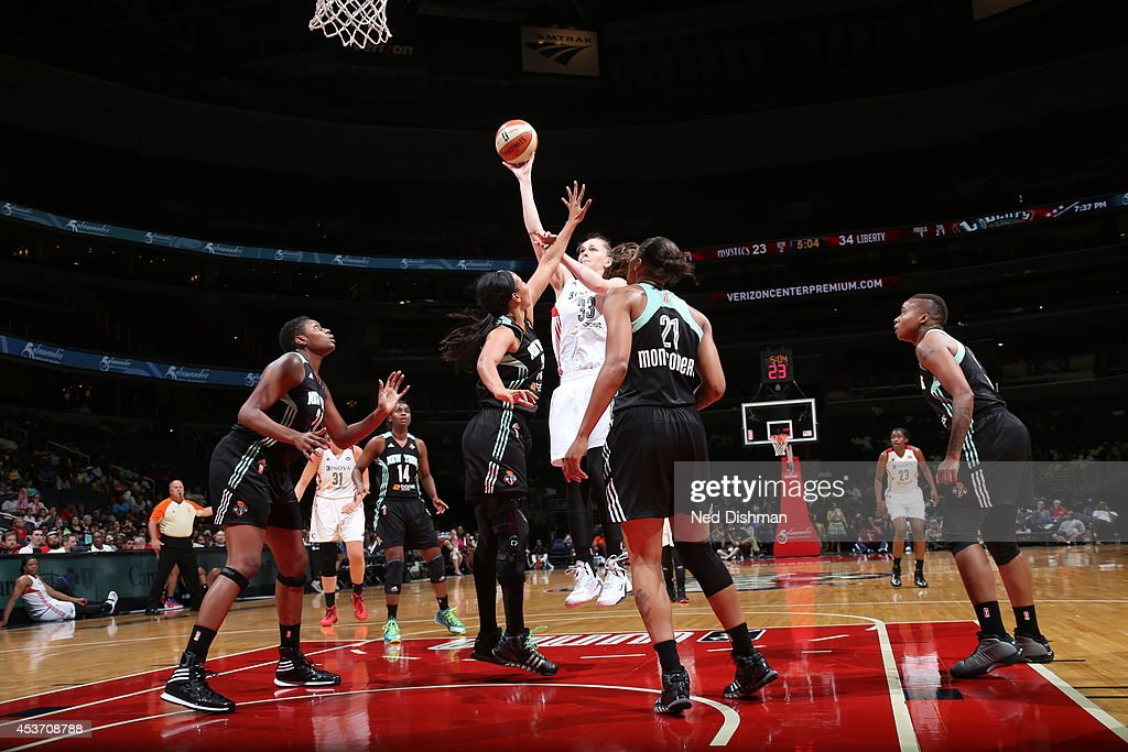 Emma Meesseman #33 of the Washington Mystics shoots against Tina Charles #31 of the New York Liberty at the Verizon Center on August 16, 2014 in Washington, DC.