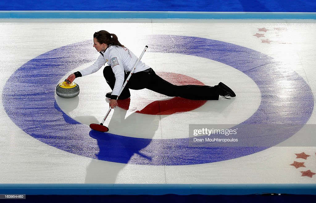 Emma Miskew of Canada throws a stone in the match between Canada and USA during Day 3 of the Titlis Glacier Mountain World Women's Curling Championship at the Volvo Sports Centre on March 18, 2013 in Riga, Latvia.