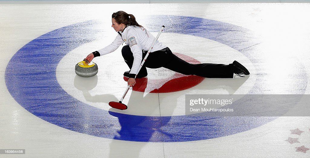 Emma Miskew of Canada throws the stone in the match between Canada and USA during Day 3 of the Titlis Glacier Mountain World Women's Curling Championship at the Volvo Sports Centre on March 18, 2013 in Riga, Latvia.