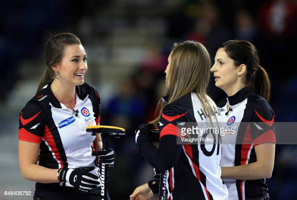 Emma Miskew Rachel Homan and Lisa Weagle of Ontario talk in a semi final match against Northern Ontario during the 2017 Scotties Tournament of Hearts...