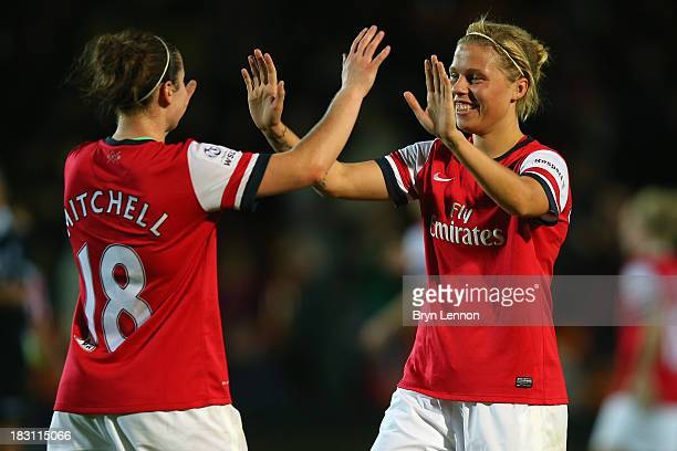 Emma Mitchell celebrates with team mate Gilly Flaherty at the final whistle after winning the FA WSL Continental Cup Final between Arsenal Ladies and...